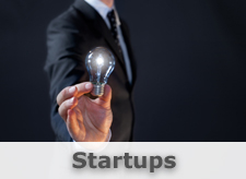 Startup Image: Business man holding up a light bulb