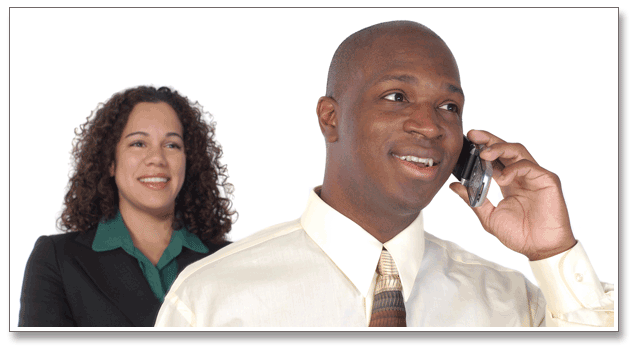 Two business people with one on cell phone.