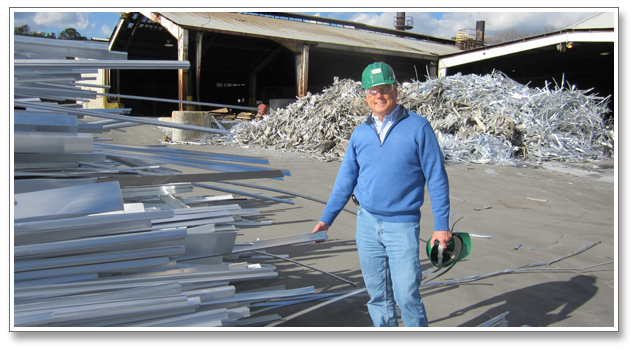 Andrew Massey, Division Manager at Bonnell Aluminum stands in front of the cast house for melting and recycling aluminum.