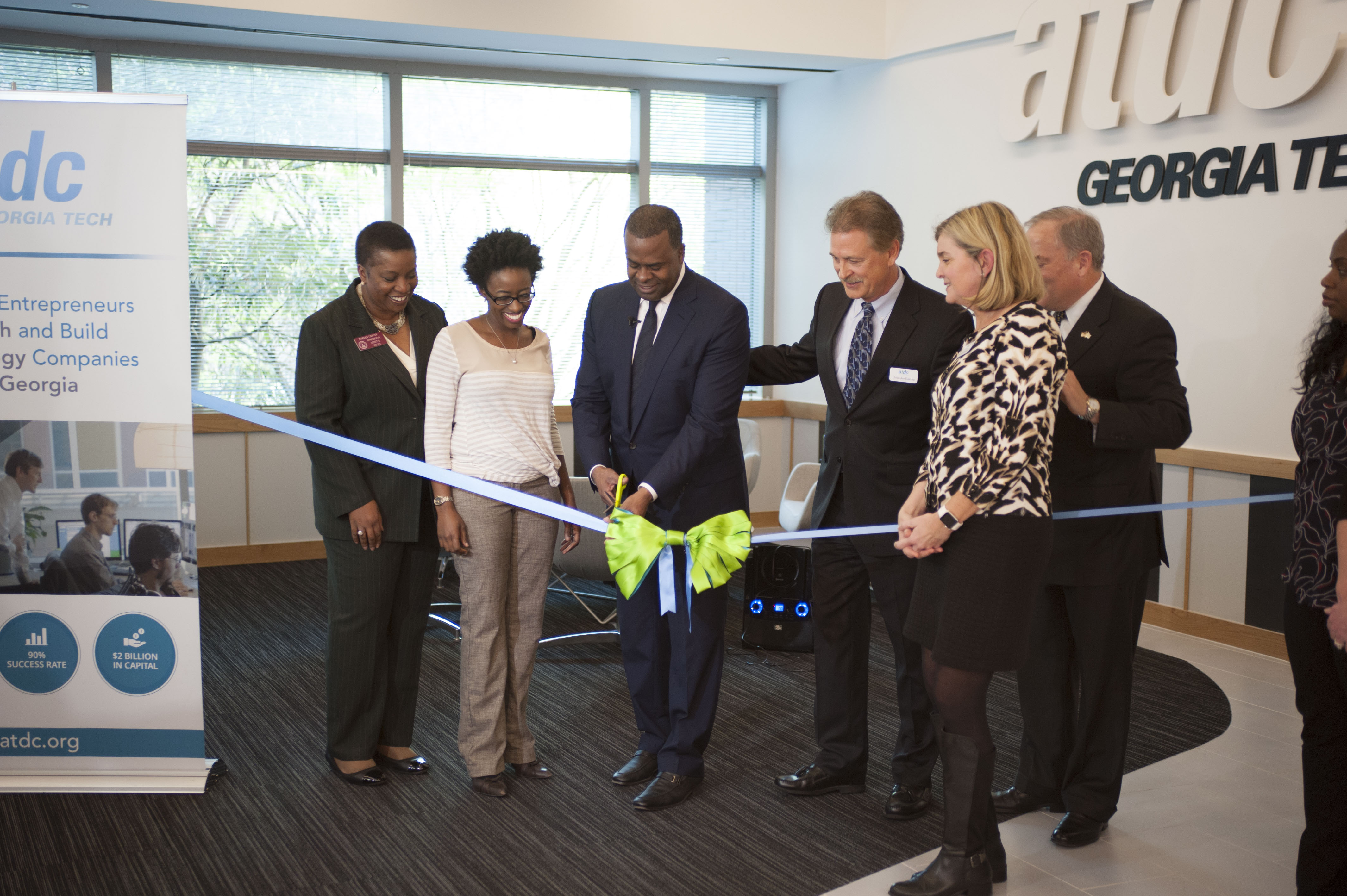 Atlanta Mayor Kasim Reed, center, cuts the ceremonial ribbon following a redesign of the space at Georgia Tech's Advanced Technology Development Center on March 23. From left: House Reps. Doreen Carter and Dar'shun Kendrick; Reed; Chris Downing, interim vice president, Enterprise Innovation Institute; Stephen E. Cross, executive vice president for research, Georgia Tech; and Jennifer Bonnett, acting general manager, ATDC.