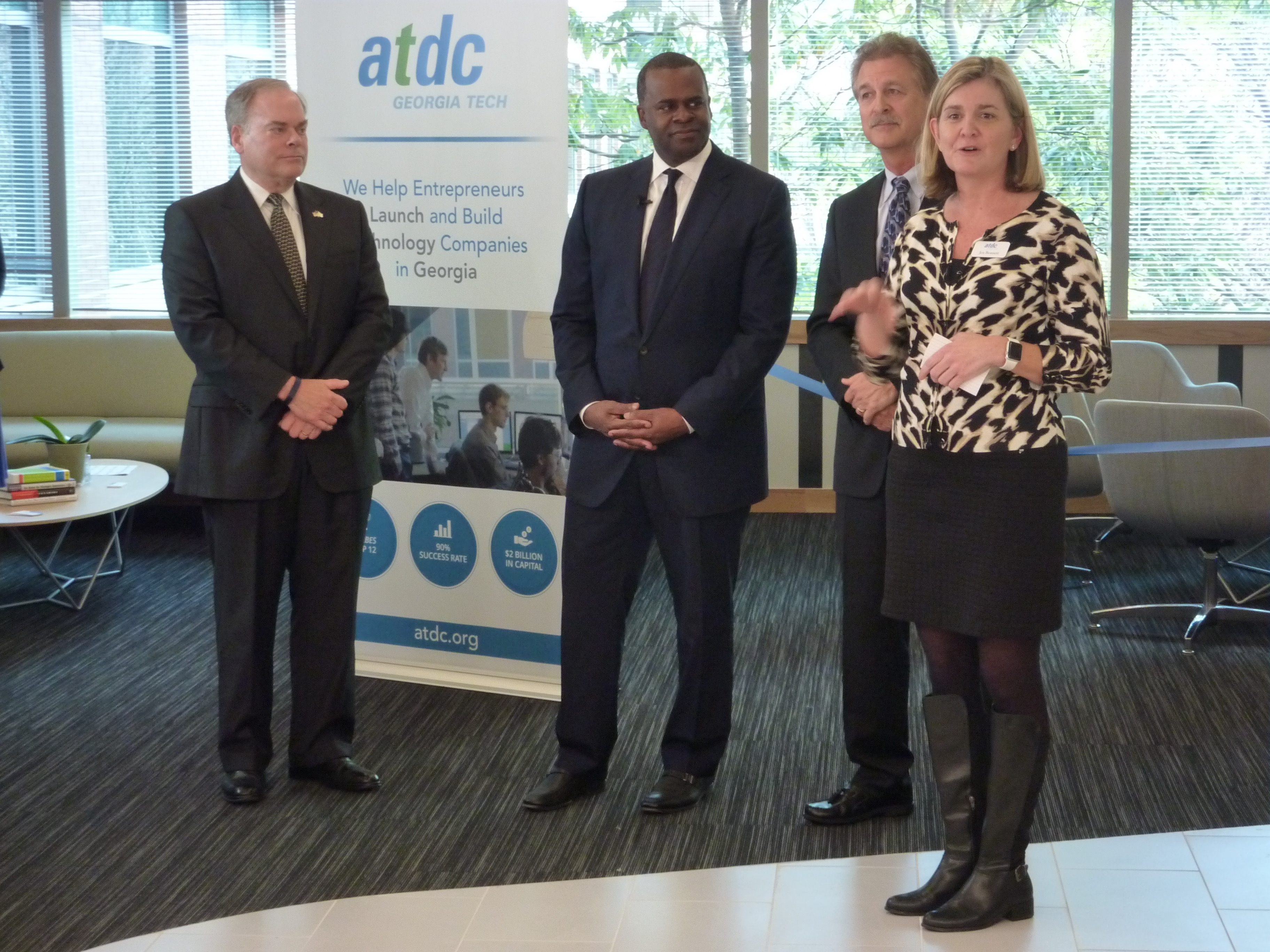 Jen Bonnett, foreground, right, addresses the Tech Square community March 23, 2016 and details the renovations made to ATDC's floor at the Centergy building in Midtown Atlanta.