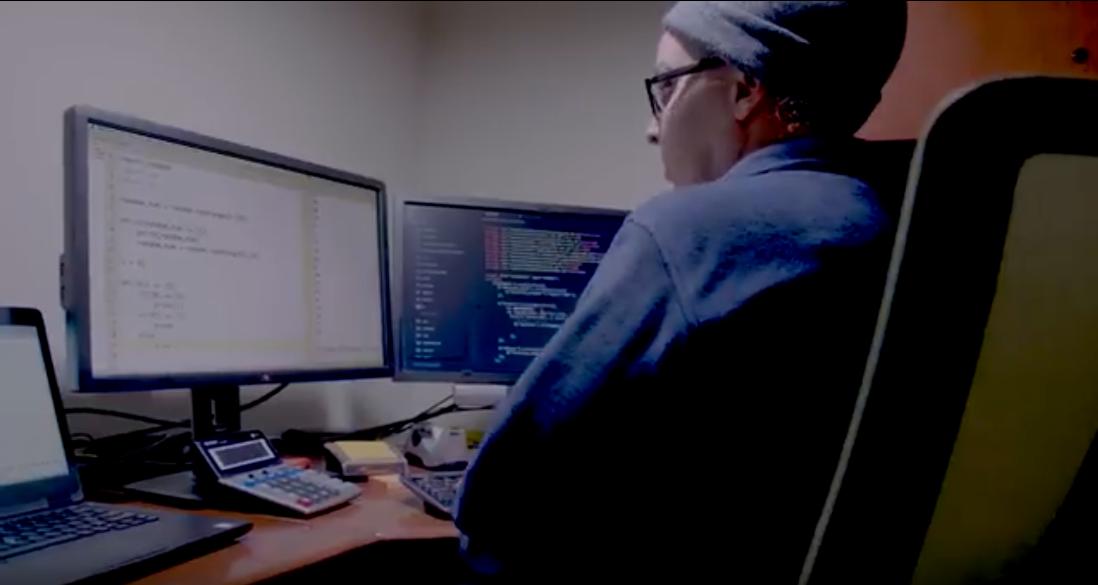 cybercriminal at a computer terminal