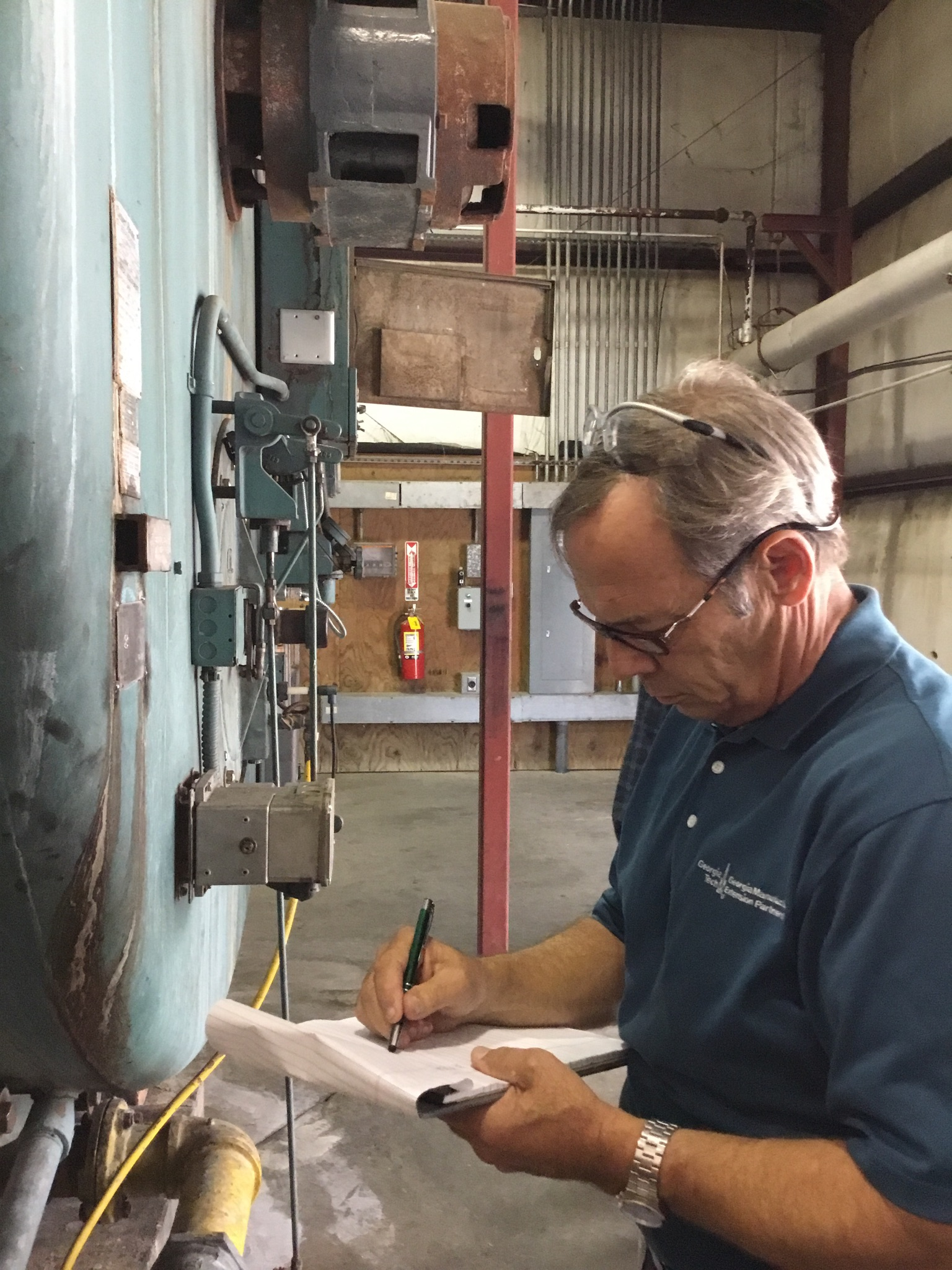 Randy Green, GaMEP project manager in the Energy and Sustainability Group, performs an energy audit with one of his clients in Emanuel County in Georgia.