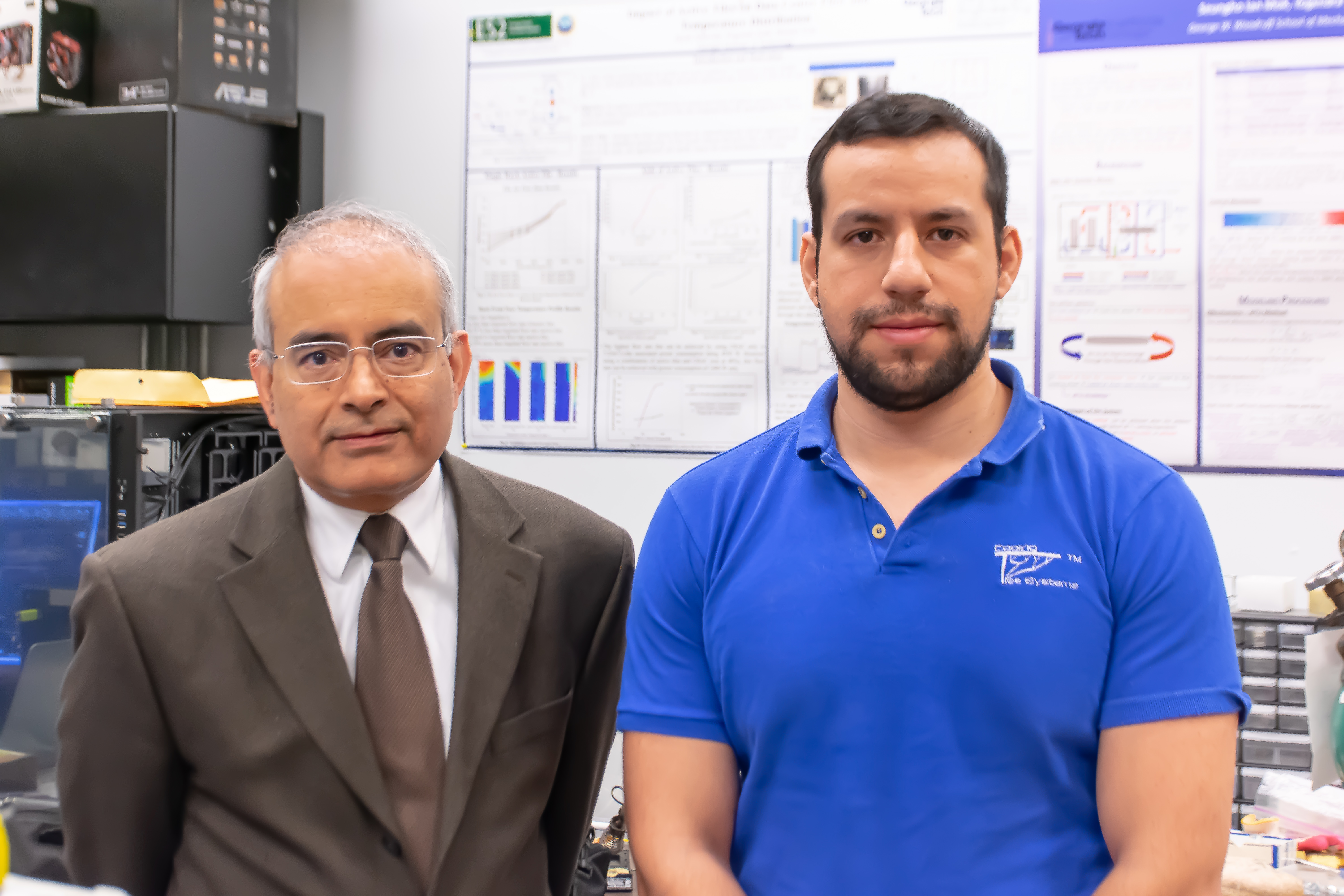 Yogendra Joshi (left) and Daniel Lorenzini stand in Joshi's lab heat transfer, combustion and energy systems lab in the George W. Woodruff School of Mechanical Engineering. (Photo: Péralte C. Paul)