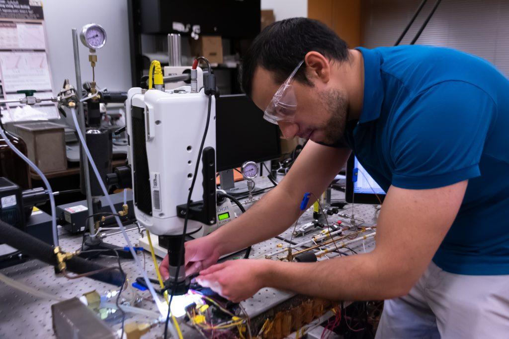 Daniel Lorenzini prepares to test a microchip as part of his liquid cooling system technology he developed at Georgia Tech. (Photo: Péralte C. Paul)
