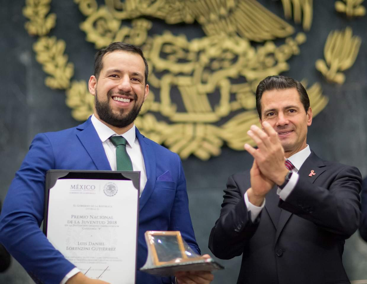 Daniel Lorenzini (left) poses for photos with former Mexican President Enrique Peña Nieto in 2018 after being awarded the Entrepreneurial Ingenuity Award from the Mexican government. (Special)