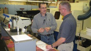 Scott Bunn, Groov-Pin's operations manager, discusses opportunities for implementing lean principles with EI<sup>2</sup>'s Sam Darwin.